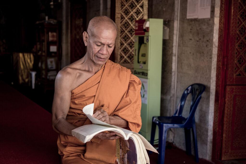 thailand monk reading temple
