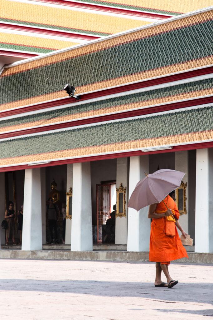 thailand bangkok grand palace monk umbrella