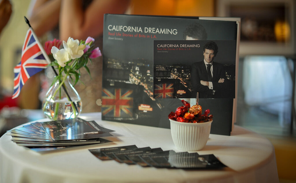 table display of book california dreaming real life stories of brits in la book launch